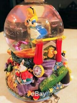 Alice In Wonderland Drink Me Snow Globe, plays All in the Golden Afternoon
