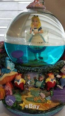 Disney Alice in Wonderland Drink Me Snow Globe All in the Golden blue water