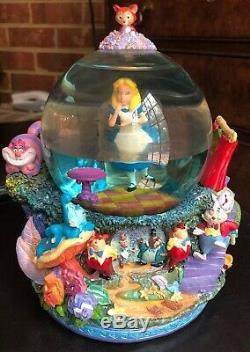 Disney Alice in Wonderland Drink me snow globe