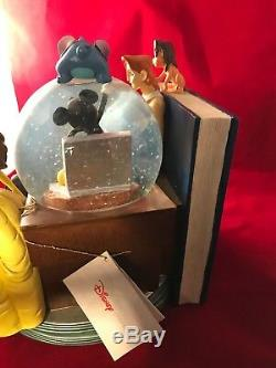 Disney Through The Years Volume II Snowglobe Bookend Musical Snow Globe 1999