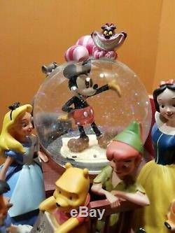 Disney Through Years Mickey Pinocchio Snow White Bambi Bookend Water Snow Globe