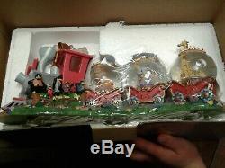 Disney rare snowglobe. Dumbo triple globe with Casey Jr. Railroad train. Musical