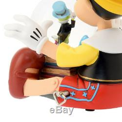 Disney store Japan Snow Dome music box with Pinocchio Jiminy Cricket Glove fig