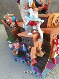 Rare Disney Alice snow globe